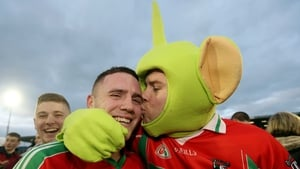 Ballymun Kichams' Davey Byrne celebrates with fan Darragh Joyce after beating Dr Crokes
