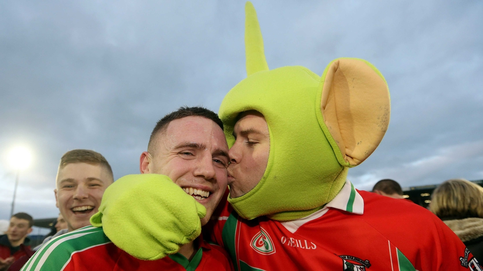 Ballymun Kichams' Davey Byrne celebrates with fan Darragh Joyce after beating Dr Crokes
