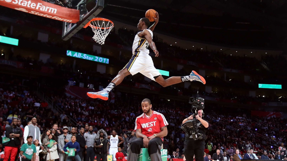Jeremy Evans dunks over Dahntay Jones during the Sprite Slam Dunk Contest part of 2013 NBA All-Star Weekend at the Toyota Center in Houston, Texas