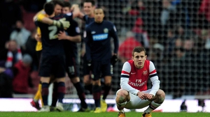 A dejected Jack Wilshere of Arsenal reacts following his team's 1-0 defeat during the FA Cup defeat against Blackburn Rovers