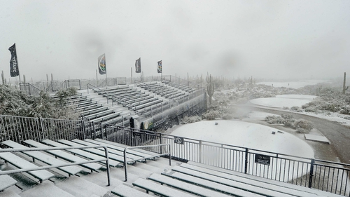 Snow covers the tee at the first hole after atrocious weather in Arizona