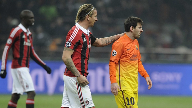 Lionel Messi of FC Barcelona and Philippe Mexes of AC Milan