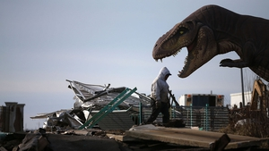 A worker cleans debris from the Fun Town Pier that was damaged by Superstorm Sandy in Seaside Heights, New Jersey