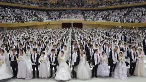 Thousands of couples take part in a mass wedding ceremony at Cheongshim Peace World Center in Gapyeong-gun, South Korea