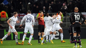 Mousa Dembele wheels away in delight after his stunner against Lyon