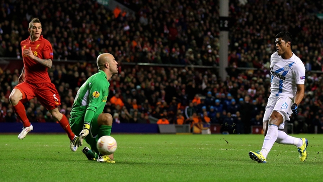 Zenit's Hulk scores the opening goal past Liverpool goalkeeper Pepe Reina