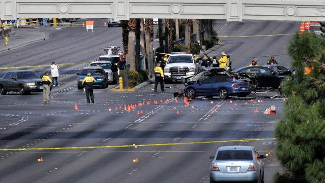 Las Vegas police investigate the scene of gun battle on the Las Vegas strip
