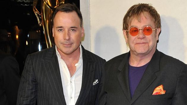 Elton with civil partner David Furnish