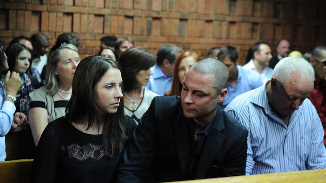 Relatives of South African Olympic sprinter Oscar Pistorius, (From L) his sister Aimee, his brother Carl, and his father Henke appear in Court
