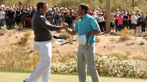 Shane Lowry congratulates Graeme McDowell after McDowell won their match 3&2