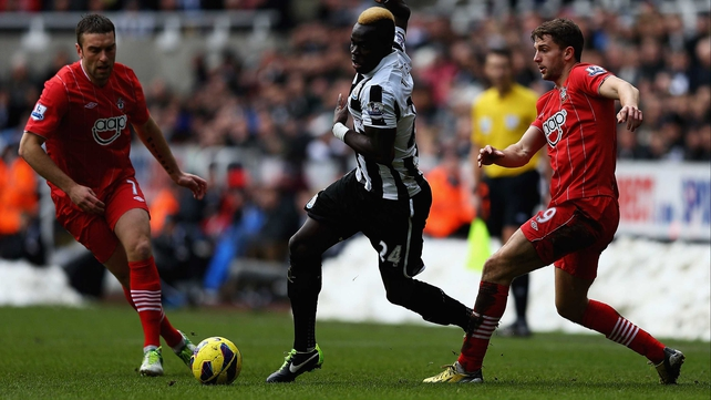 Cheick Tiote takes on two Southampton players during their Premier League clash