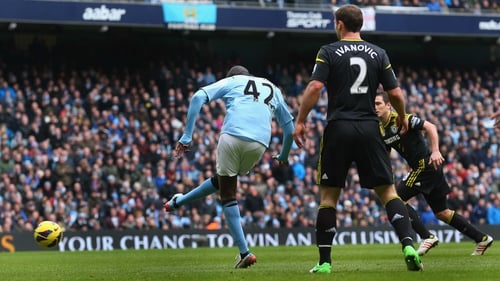 Yaya Toure turns his body around the ball to give City the lead