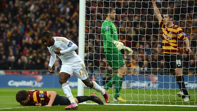 Nathan Dyer wheels away in delight after opening the scoring for Swansea in the Capital One Cup final