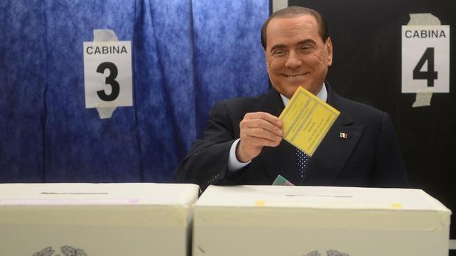 Former premier Silvio Berlusconi casts his vote in the Italian election
