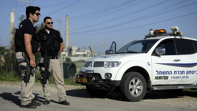 Israeli security forces stand guard in the southern city of Ashkelon after the strike