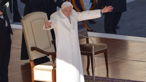 Pope Benedict XVI waves from the altar as he arrives on St Peter's square for his last weekly audience