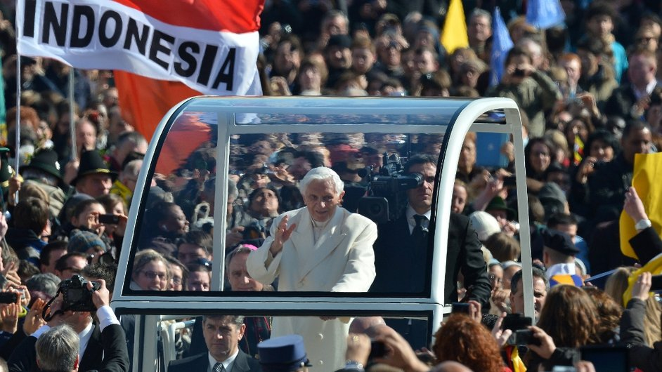 Benedict waves from his popemobile as he arrives on St Peter's Square