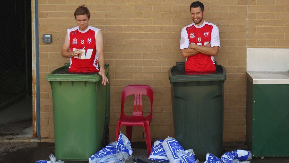Matt Thompson and Josip Tadic take an ice bath during a Melbourne Heart A-League training session at La Trobe University