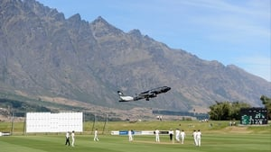 An Air Zealand plane flies overhead during the International tour match between New Zealand XI and England at Queenstown
