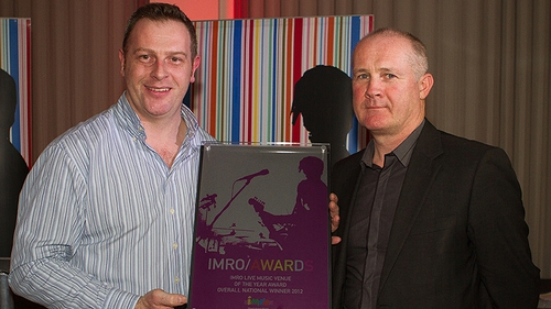 Robert Monroe of Monroe's (l) receives the award from Victor Finn, CEO of the Irish Music Rights Organisation (IMRO) - Photo: Kieran Frost
