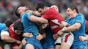 Simone Favaro and Mike Phillips struggle during the RBS 6 Nations match between Italy and Wales