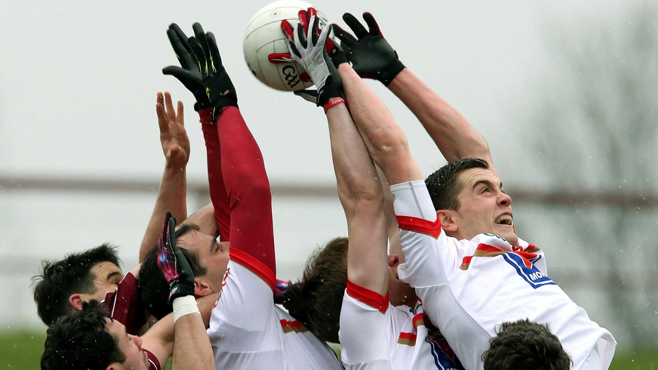 Louth and Galway players contend a high ball during their Allianz League clash