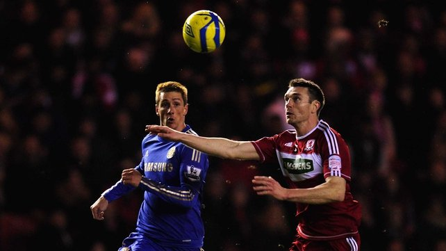 Chelsea player Fernando Torres is challenged by Boro defender Stephen McManus