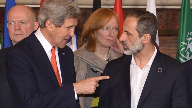 John Kerry (L) speaks to Syrian opposition leader Moaz al-Khatib at the 'Friends of Syria' meeting in Rome