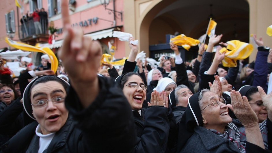 Nuns cheer as Pope Benedict appears on the balcony at the Papal summer residence of Castel Gandolfo