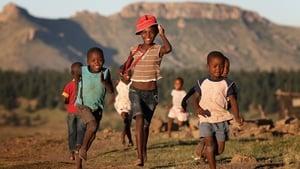Children run towards charity workers from Sentebale in Morija, Lesotho