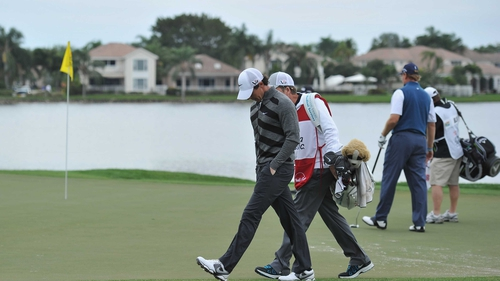 McIlroy walks off the tee at 18