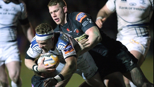 Ian Madigan is tackled by Patrick Leach and Jack Dixon