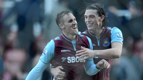 Jack Collison celebrates with Andy Carroll after his first-half strike against Stoke