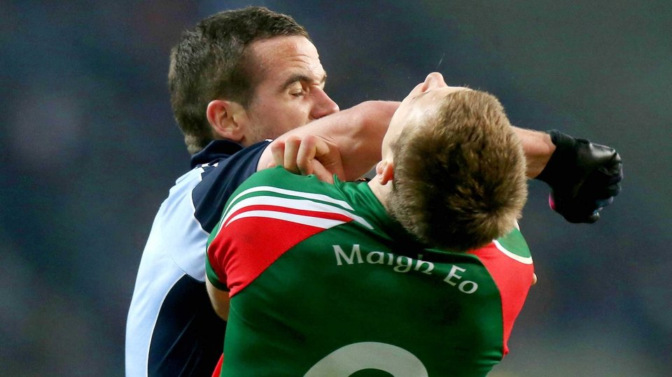 Dublin defender Ger Brennan's elbow meets the face of Mayo's Donal Vaughan
