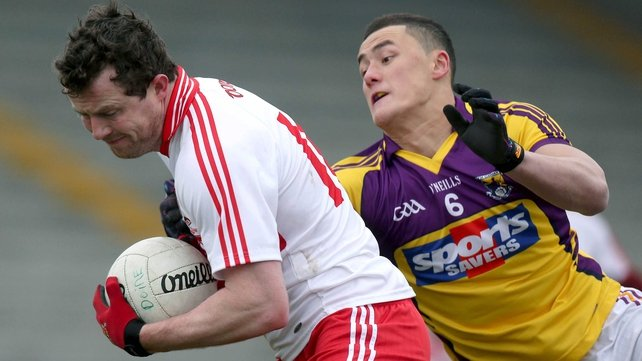 Barry McGoldrick of Derry and Wexford's Lee Chin