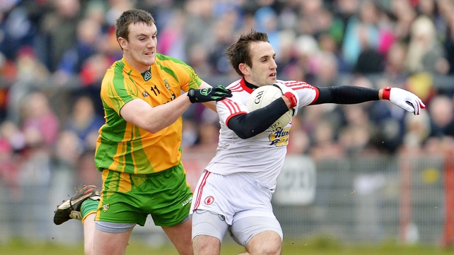 Tyrone's Mark Donnelly tries to escape the clutches of Donegal's Leo McLoone