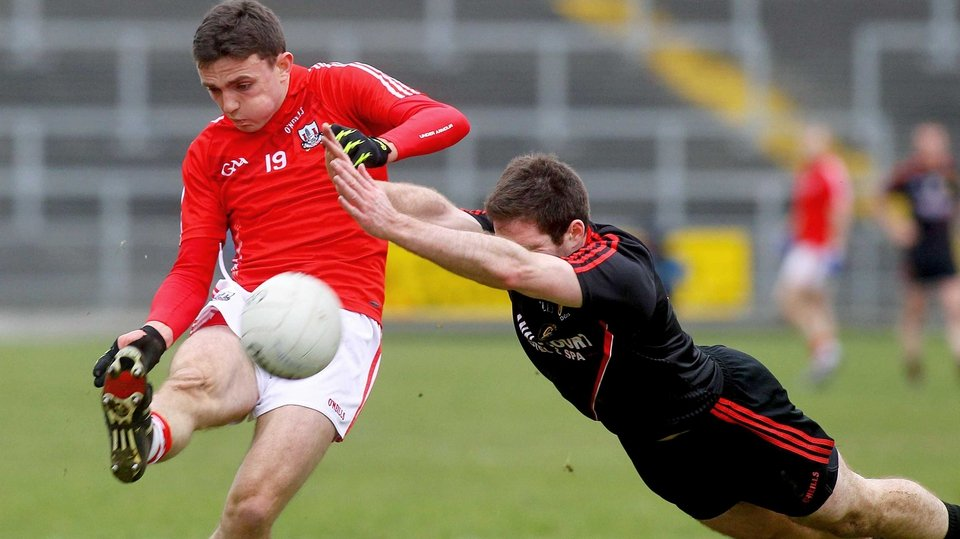 Down's Aidan Carr with Cork's Mark Collins