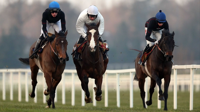 Dessie Hughes' Our Conor (centre) works with stablemates Minsk (left) and Posiden Sea