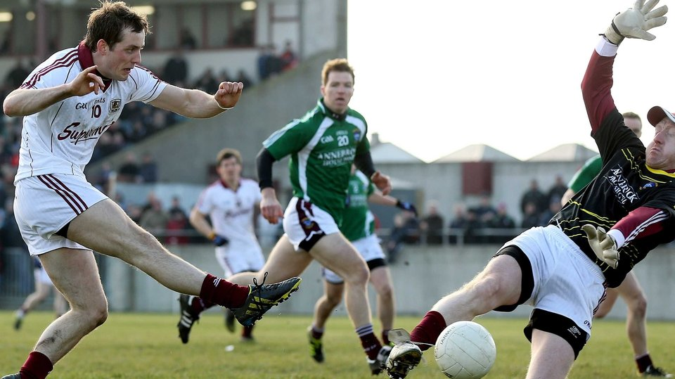 Westmeath's goalkeeper Gary Connaughton saves a goal-bound effort from John O'Brien of Galway