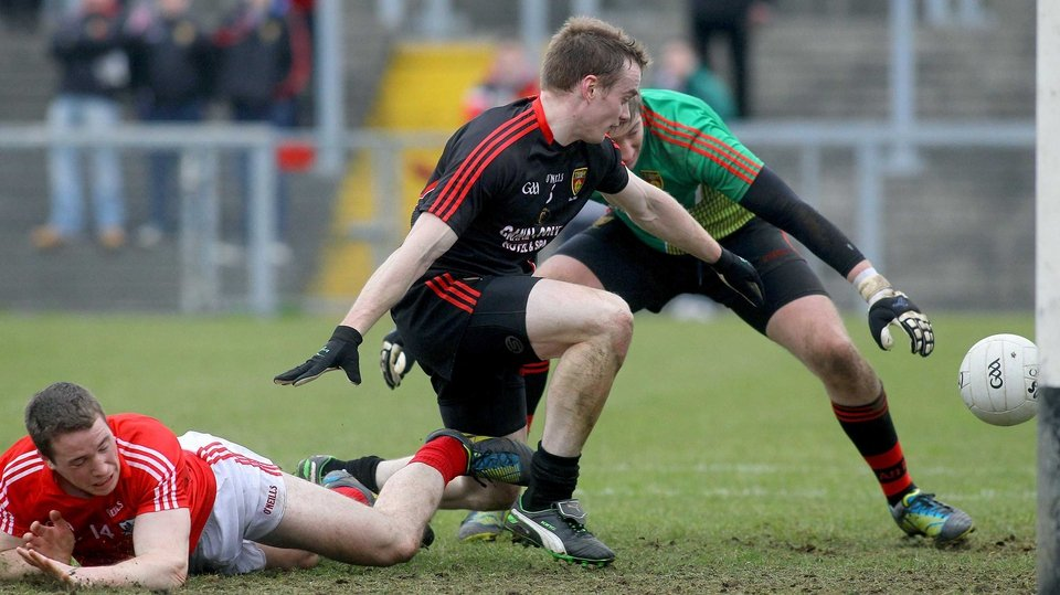 Down's Brendan McArdle and Michael Cunningham can't stop Cork's Colm O'Neill from scoring