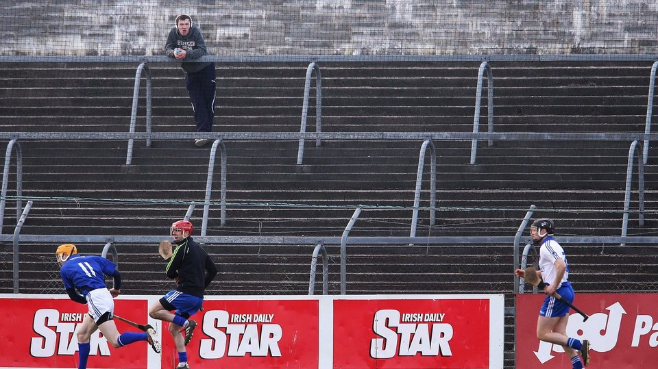 A lone spectator watches on during the Munster v Connacht interprovincial match in Ennis