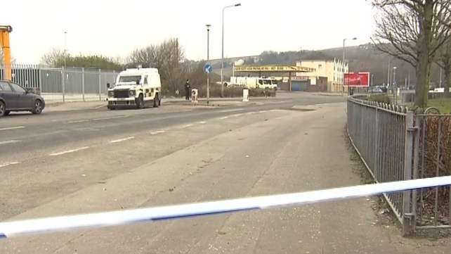 A petrol bomb and missiles were thrown at police as evacuations of the homes were carried out