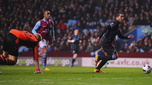 Carlos Tevez rounds Brad Guzan before scoring