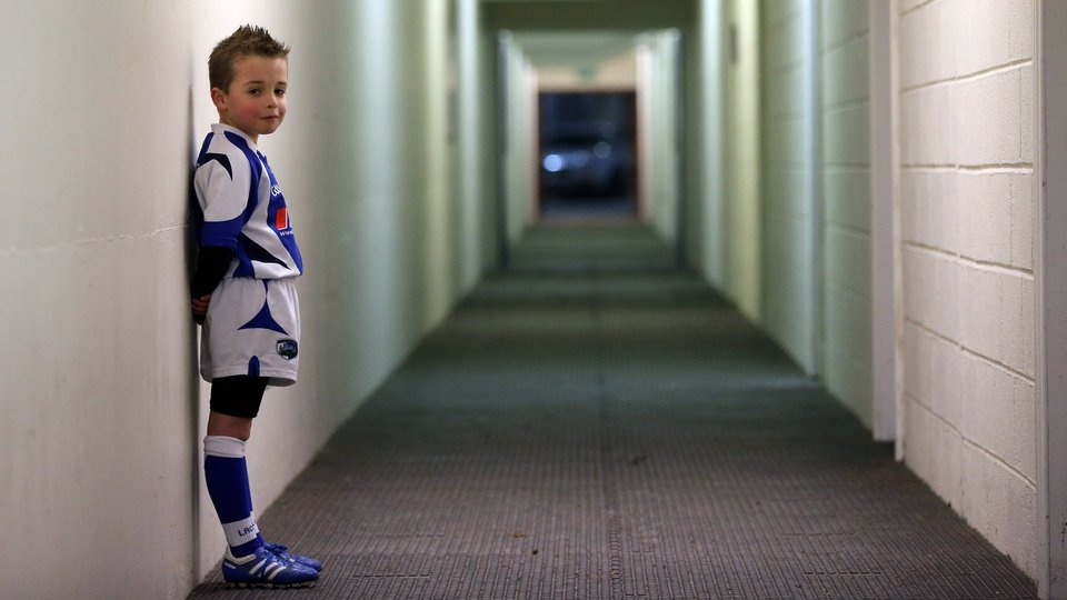 Laois mascot Cian Bailey, 8, waits for the teams before the clash with Louth