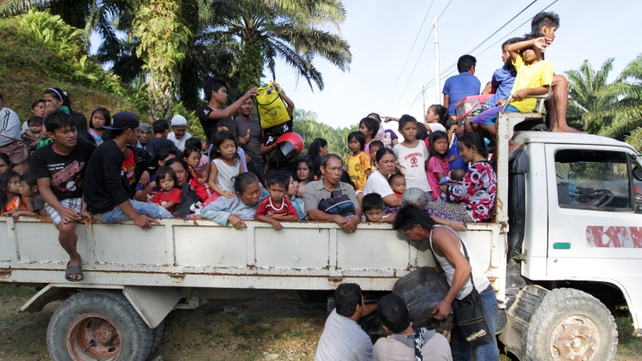 Residents leave their village in Tanjung Labian near Tanduo - close to where the assault was launched