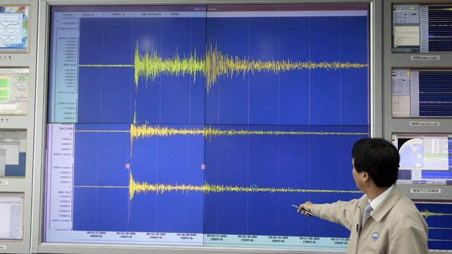 A South Korean meteorological official shows seismic waves from the site of North Korea's nuclear test in May 2009
