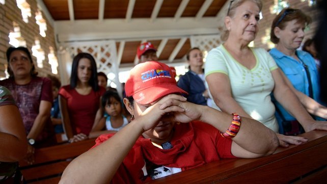 Venezuelans prayed for Mr Chavez in the chapel of the hospital before news of his death was announced