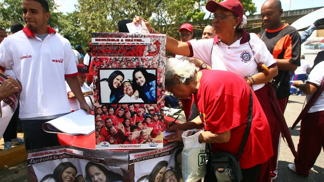 Supporters wrote messages outside the Military Hospital where Mr Chavez was being treated