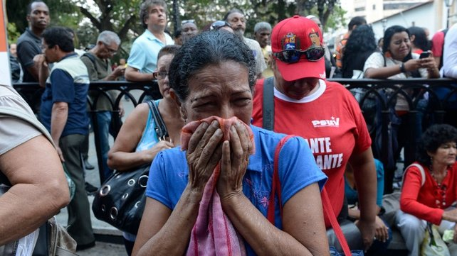 People react to the official announcement of Mr Chavez's death