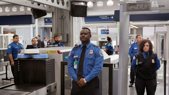 TSA staff at a security point in Chicago's O'Hare Airport